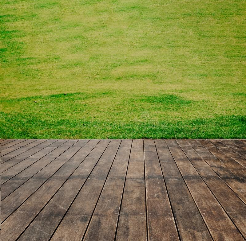 Wooden floor texture of terrace with green lawn.  royalty free stock photos