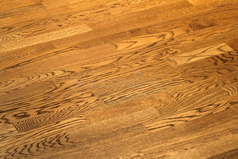 Wooden floor. Vintage wood floor with grains and knots royalty free stock image