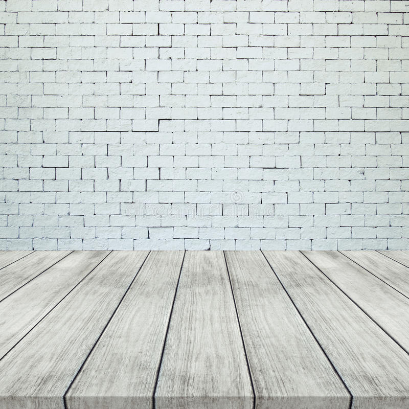 Wooden floor and white brick wall for texture background stock images