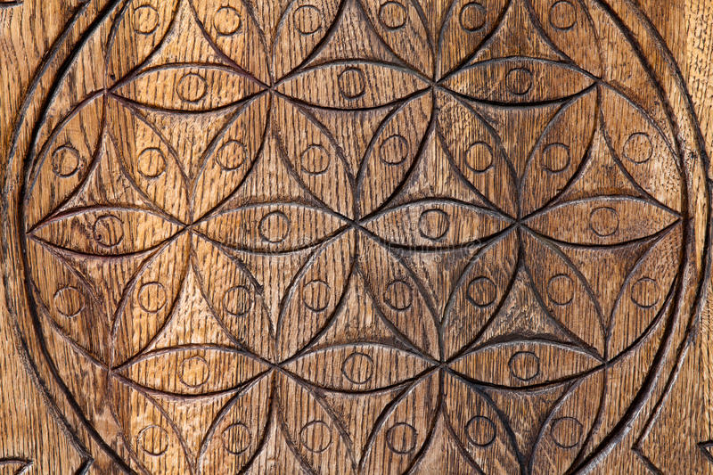 Wooden Flower of Life. The Flower of life is an ancient symbol of Sacred Geometry and represents the fundamental order of creation royalty free stock photo