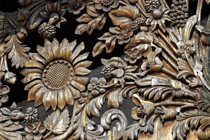 Wooden flower pattern. Manual woodcarving stock photography