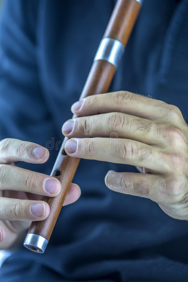 Wooden flute player royalty free stock photography