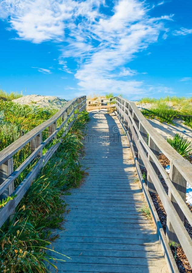 Wooden footbridge on the beach royalty free stock photos