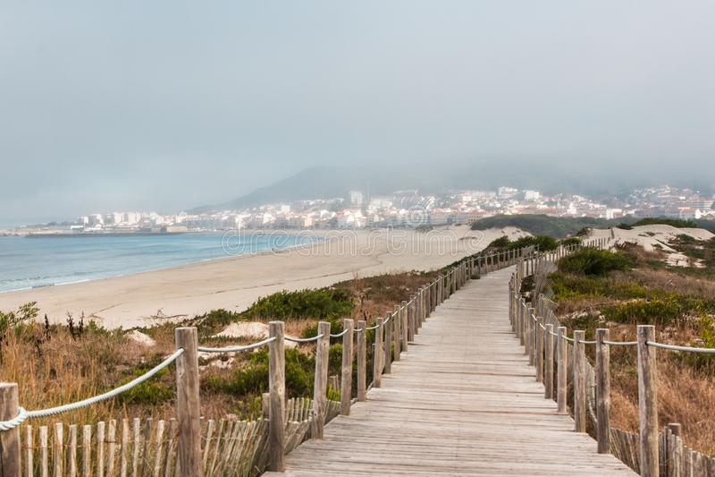 Wooden footpath at the beach. Portugal royalty free stock photography