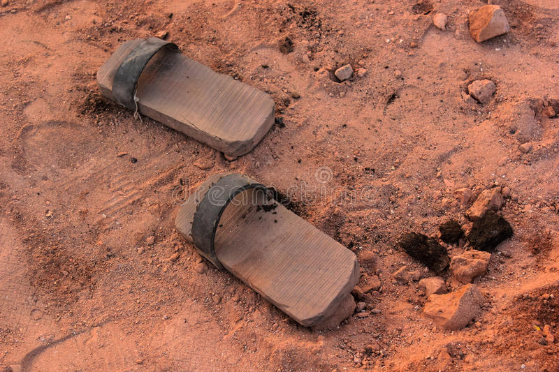 Wooden footwear, brick manufacturing. Such wooden footwear are used at brick manufacturing sites where they fire the brick to strength and hardness. Kiln they royalty free stock images