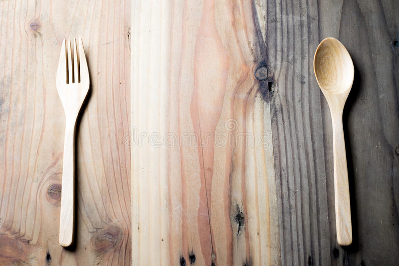 The wooden fork and spoon on a wood table stock photography