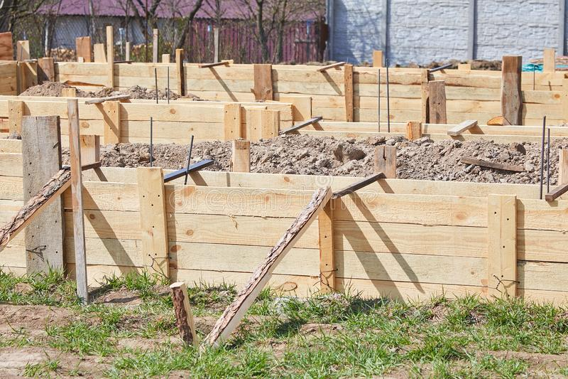 Wooden formwork concrete strip foundation for a cottage stock image