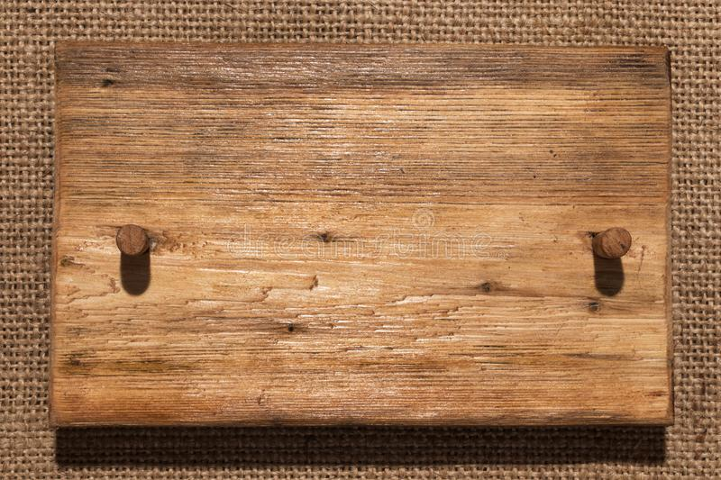 Wooden frame made of wood with wooden gag lies on burlap. With a place for your text royalty free stock photography