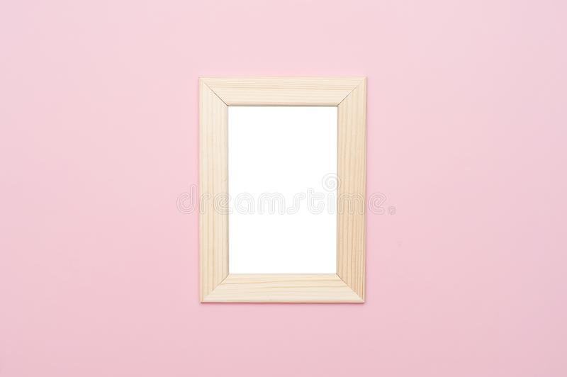 Wooden frame mock up on pastel pink background. stock photography
