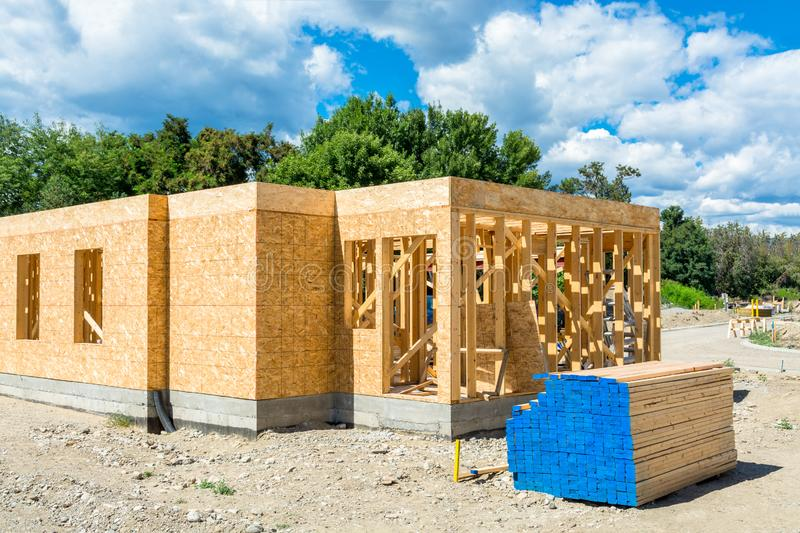 Wooden frame of new building with lumber materials prepared for construction. Wooden frame of new building with engineered lumber materials on site prepared for stock photography