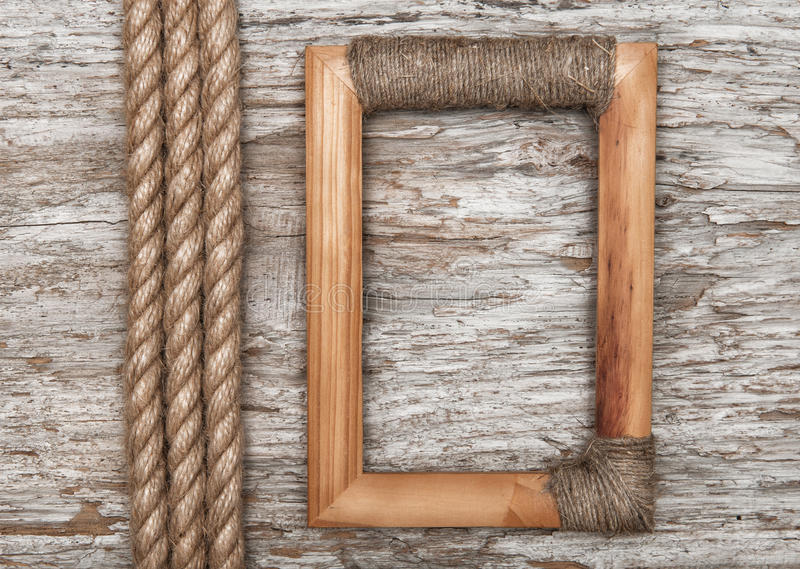 Wooden frame and rope on the old wood royalty free stock photo