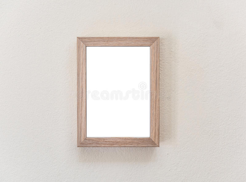 Wooden frame on white wall royalty free stock photo