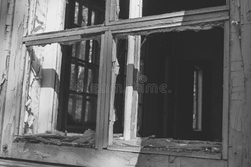 Wooden frames of broken windows in an abandoned house royalty free stock photos
