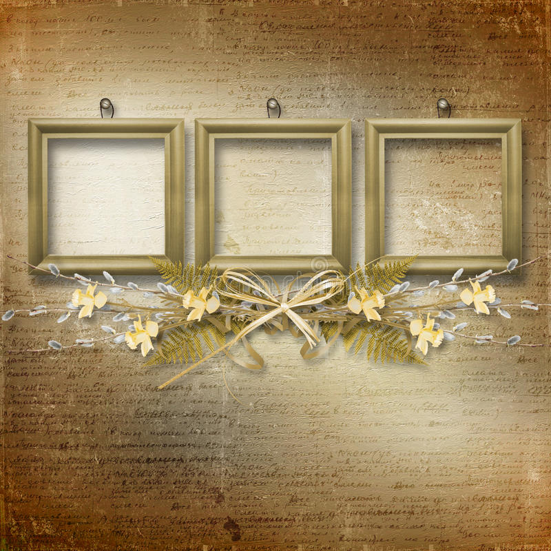 Wooden frames with bunch of willow. And narcissus royalty free stock photos