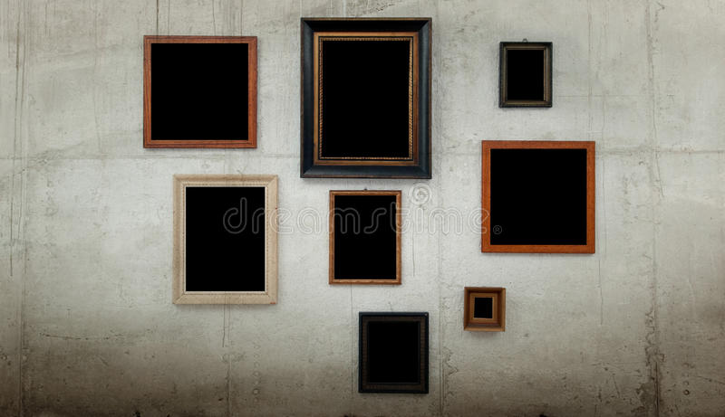 Wooden frames on concrete wall stock photo