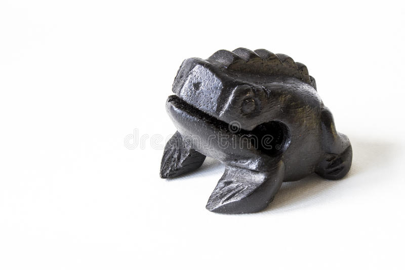 A wooden frog. Souvenir from Thailand. Financial success stock image