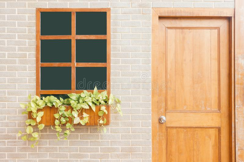 Wooden front door of a home. Front view of a wooden front door on a yellow house. royalty free stock image
