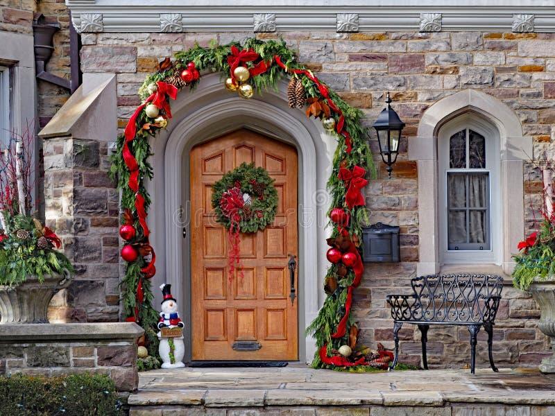 Wooden front door with wreath stock images