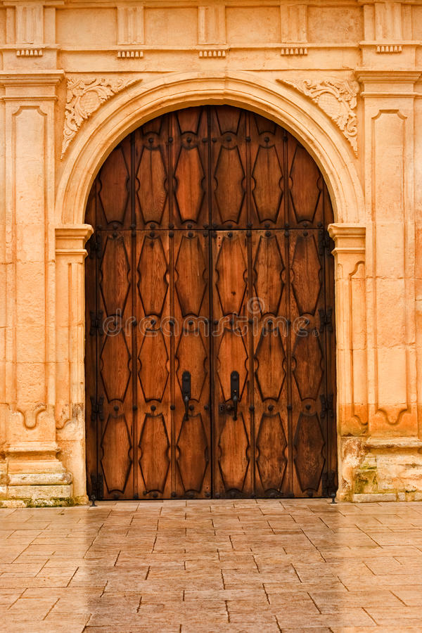 Wooden front doors of San Carlos Cathedral royalty free stock photos