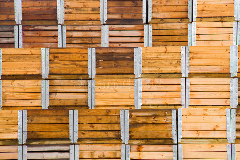 Wooden fruit packaging shipping crates. Stack of wooden industrial packaging storage and shipping fruit crates stock photos