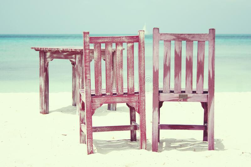 Wooden furniture on beach royalty free stock photos
