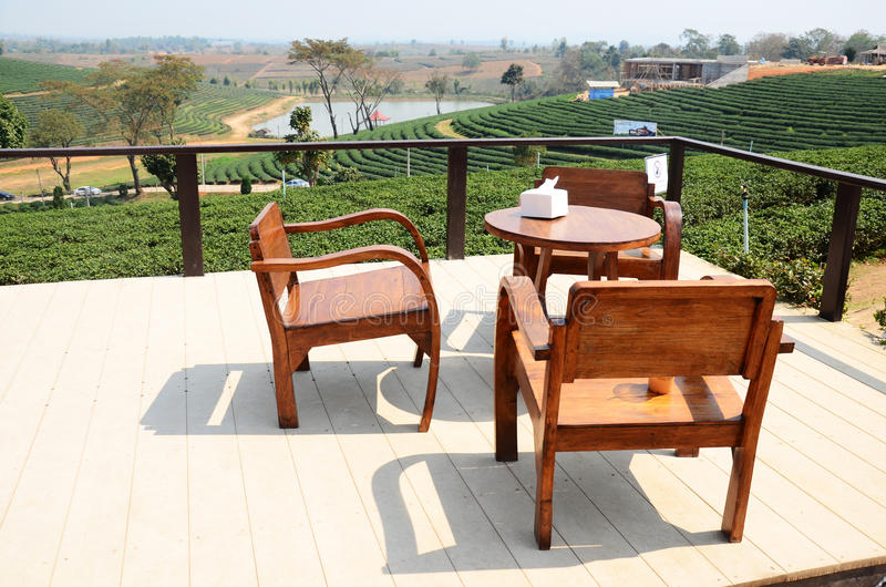 Wooden Furniture at tea plantation in Chiang Rai, Thailand. Doi Mae Salong (Thai: ดอยแม่สลอง) is a mountain royalty free stock image