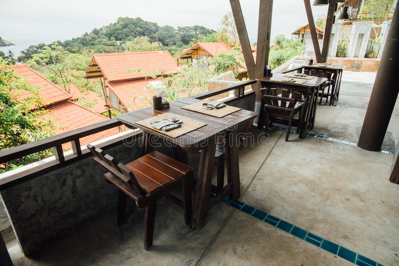 Wooden furniture on veranda cafe on background red roofs bungalow. Dining table setting at cafe. Wooden tables and chairs in a summer cafe beautiful ... & Wooden Furniture On Veranda Cafe On Background Red Roofs Bungalow ...