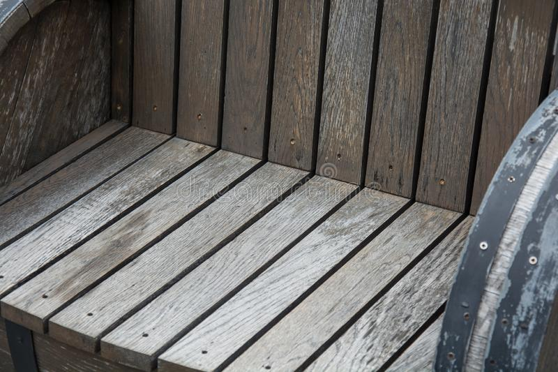 A wooden garden chair seat in a detail. The A wooden garden chair seat in a detail stock photo