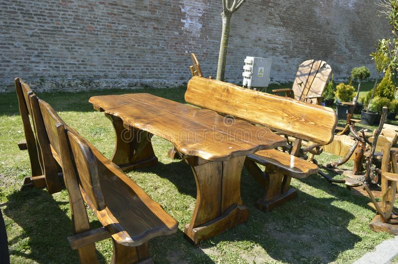 Wooden garden furniture, chairs and table. stock photos