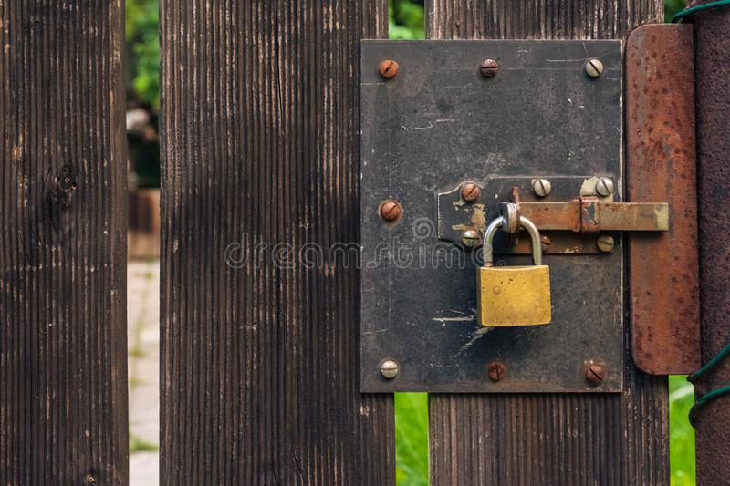 Wooden Garden Gate Rough Texture with Padlock Rusty Rustic Outdo. Ors royalty free stock photo