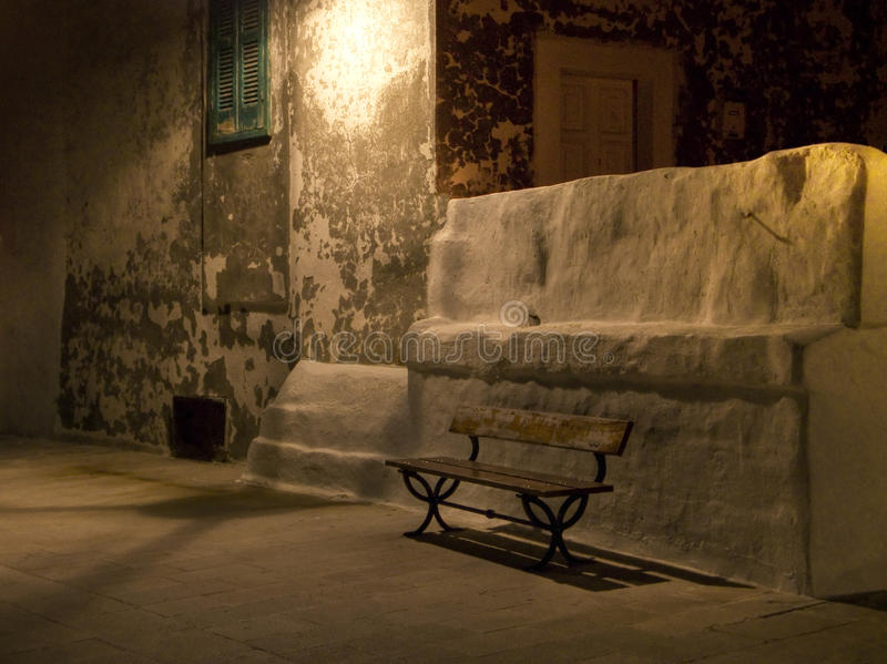 Wooden garden seat by night. Monopoli. Apulia. royalty free stock image