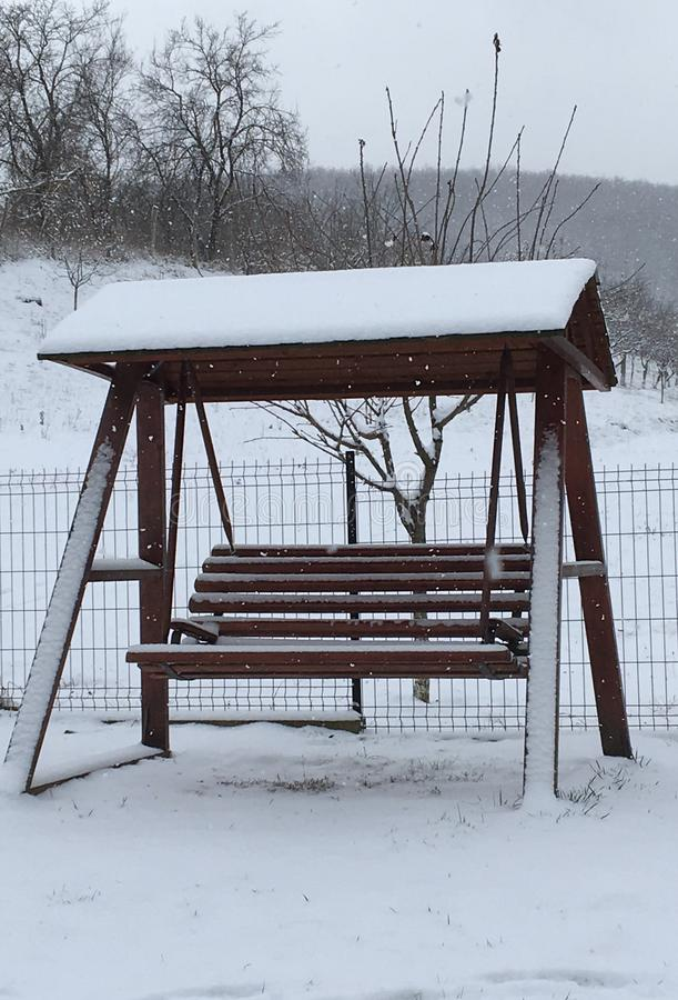 Wooden swing at winter time stock image