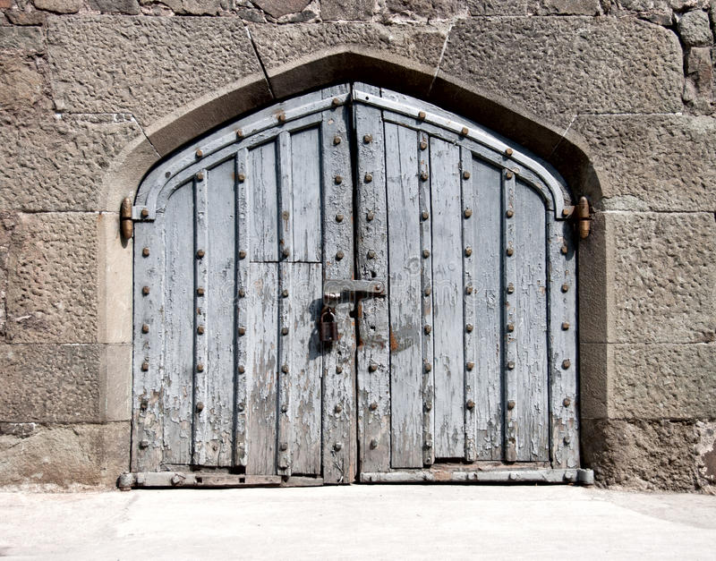 Wooden gate in an ancient palace. Heavy wooden gate in an ancient palace royalty free stock images