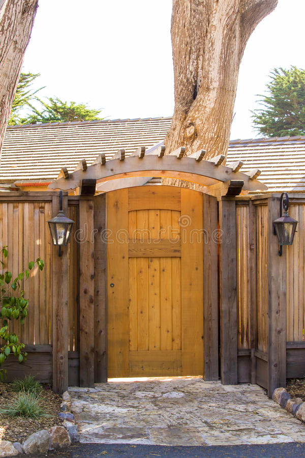 Wooden gate as an entrance to the house stock image