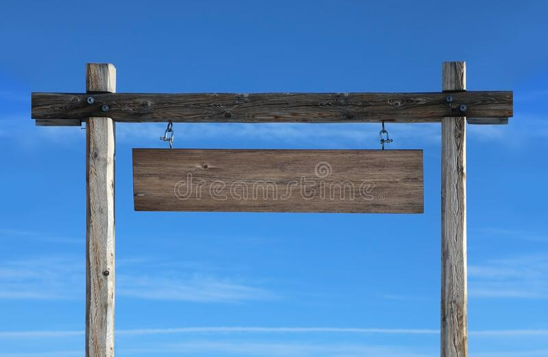 Wooden gate with a blank sign against the blue sky stock image
