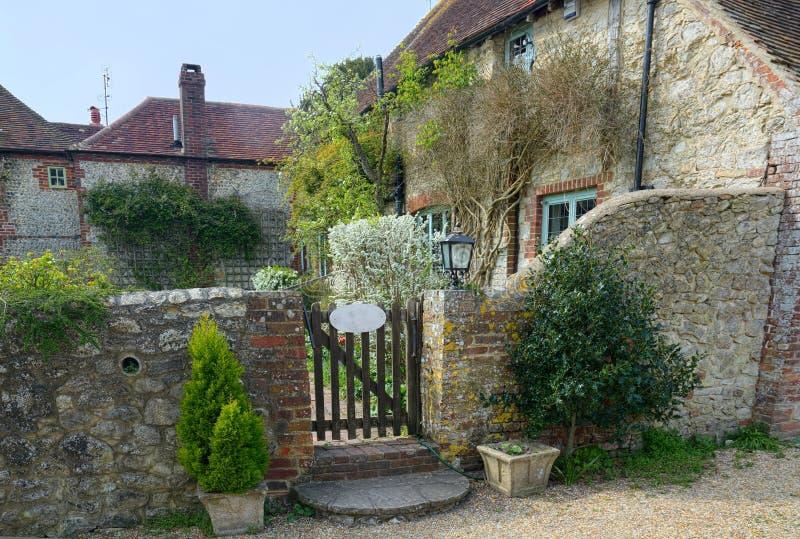 Garden Gate, Picturesque stone cottage stock photos