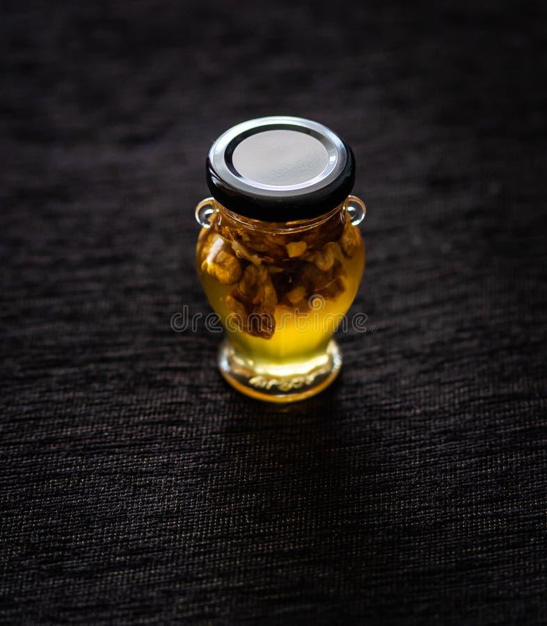 Honey with walnuts royalty free stock photos