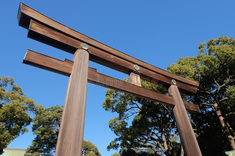 Wooden gate and tree at Meiji shrine in Tokyo, Japan stock image