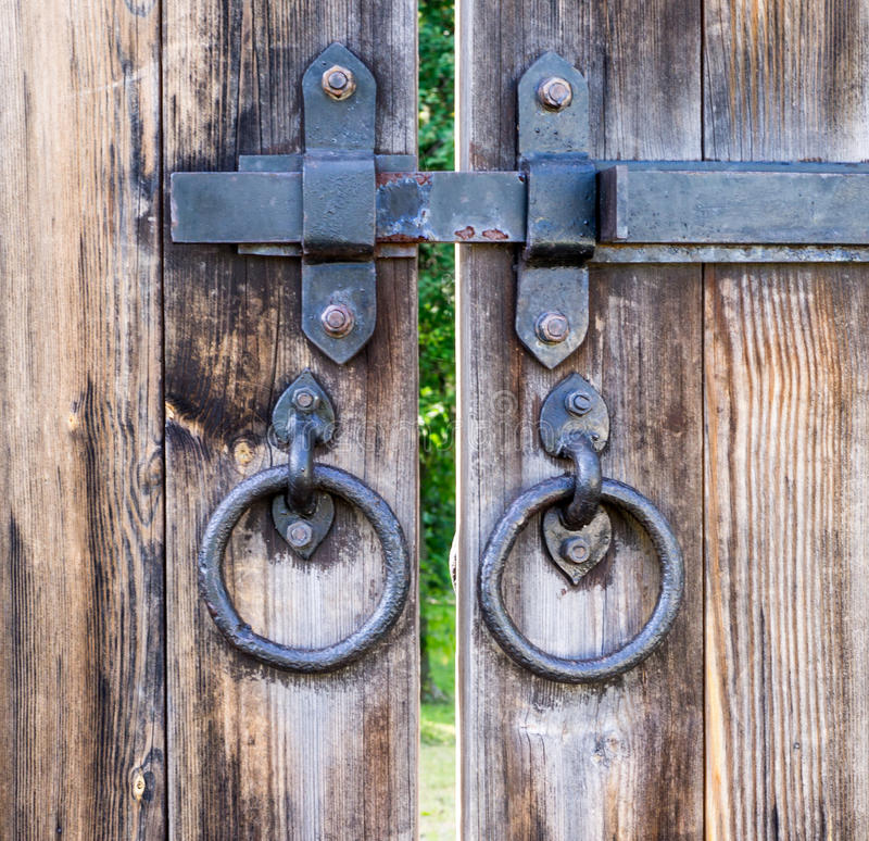 Wooden gates with knobs. background, exterior royalty free stock photography