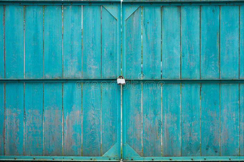 Wooden gates with padlock stock photo