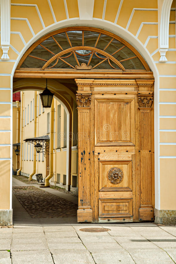 Wooden gates in the yard. Wooden old gates with element of decoration on the door stock photos