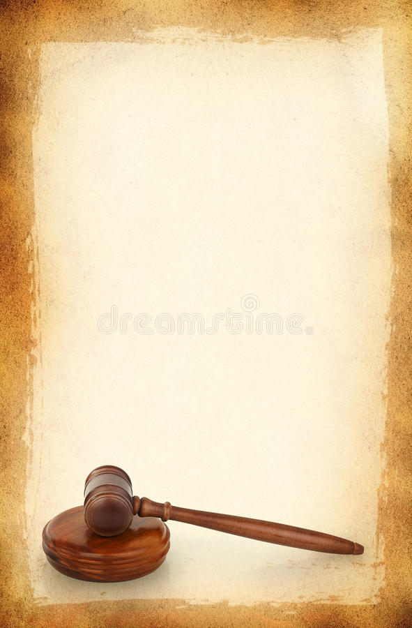 Wooden gavel against old dirty background stock photography