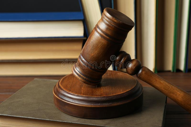 Wooden gavel and books on table, closeup. Law concept royalty free stock images