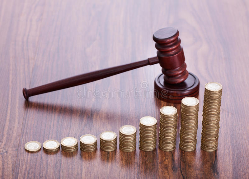 Wooden gavel with coins royalty free stock photos