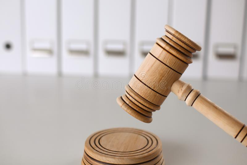 Wooden gavel and folders on wooden table, close up.  stock photo