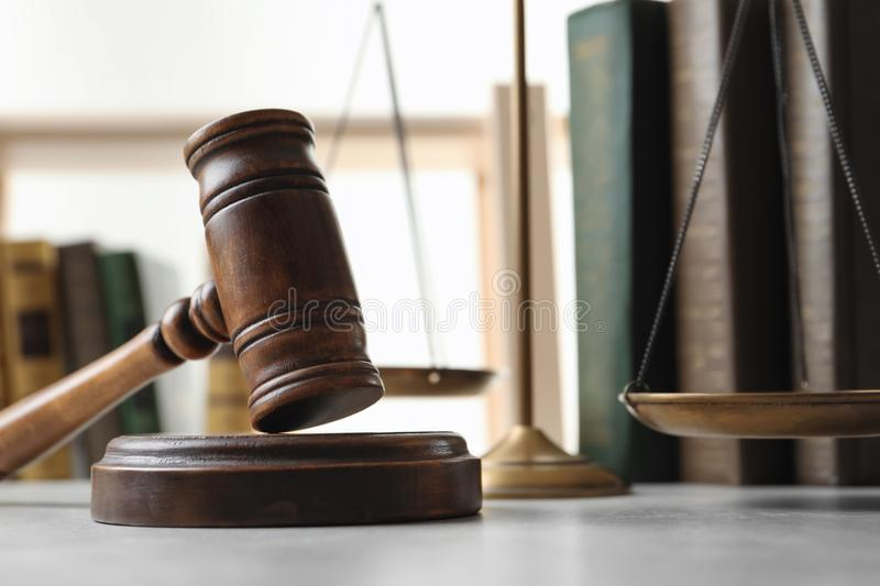 Wooden gavel, scales of justice and books. On table, closeup. Law concept stock image