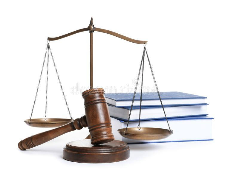Wooden gavel, scales of justice and books. On white background. Law concept stock images