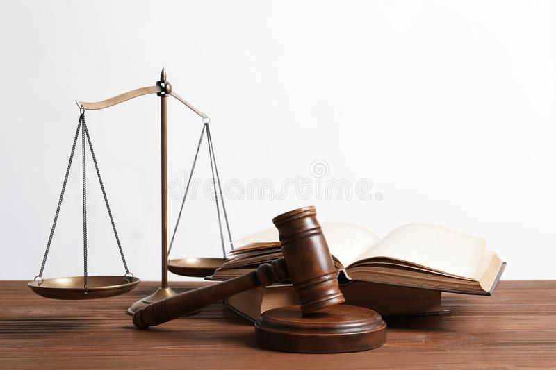Wooden gavel, scales of justice and books. On table. Law concept royalty free stock images