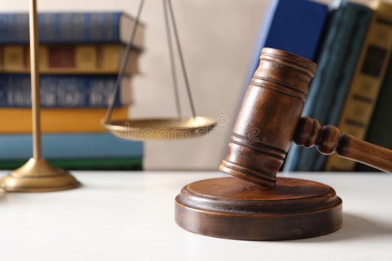 Wooden gavel, scales of justice and books. On table. Law concept stock photo