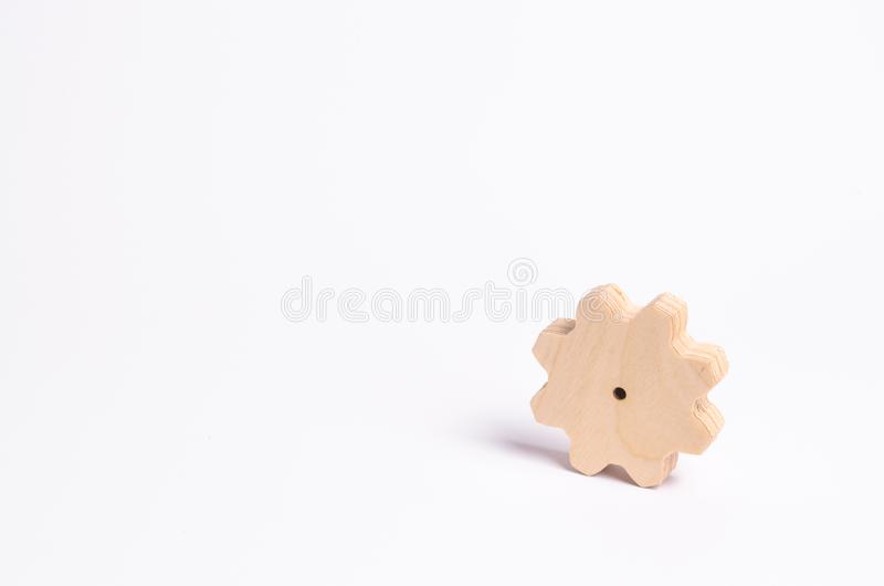 Wooden gear on a white background. Abstract background for presentations and banners. The concept of technology and industr. Y, the think process. Part of a stock photography
